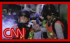 CNN reporter and crew hit by tear gas in Hong Kong