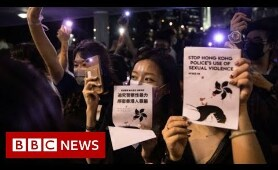 Hong Kong park lights up in sex abuse protest - BBC News