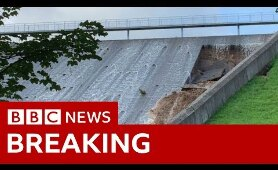 Town evacuated as dam wall collapses - BBC News